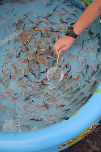 Cropped hand fishing outdoors
