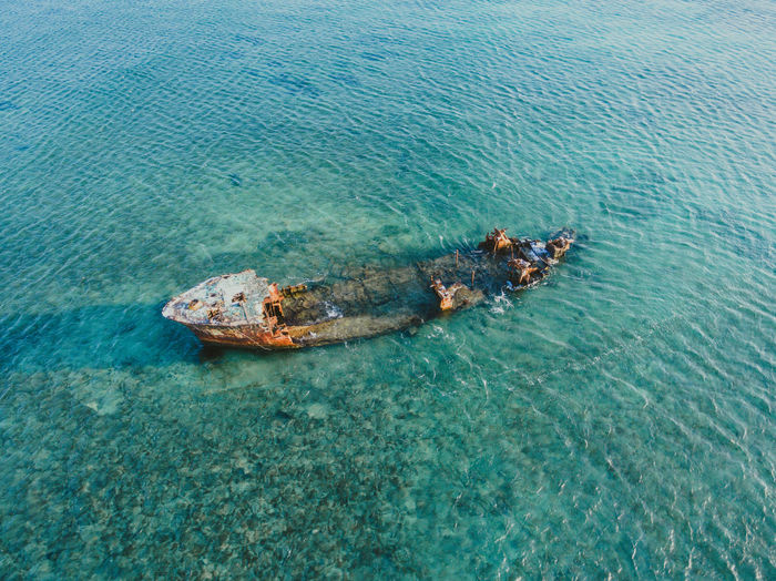 Shipwreck at the coast of Aruba. ArealPhotography Aruba Blue Ocean Caribbean Sea Drone  Air Shot Areal View Beach Beachphotography Caribbean Drone Photography Dronephotography High Angle View Ocean One Happy Island Paradise Paradise Beach Seascape Shipwreck Shipwreck Beach Turquoise Colored Water