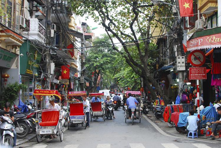 People and rickshaws on hanoi street