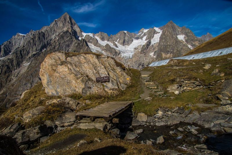 mallatra,val ferret,courmayeur,italy Mountain Scenics - Nature Sky Mountain Range Nature Environment Day Beauty In Nature Solid No People Landscape Rock Cloud - Sky Tranquility Snow Outdoors Cold Temperature Rock - Object Tranquil Scene Mountain Peak Formation Snowcapped Mountain