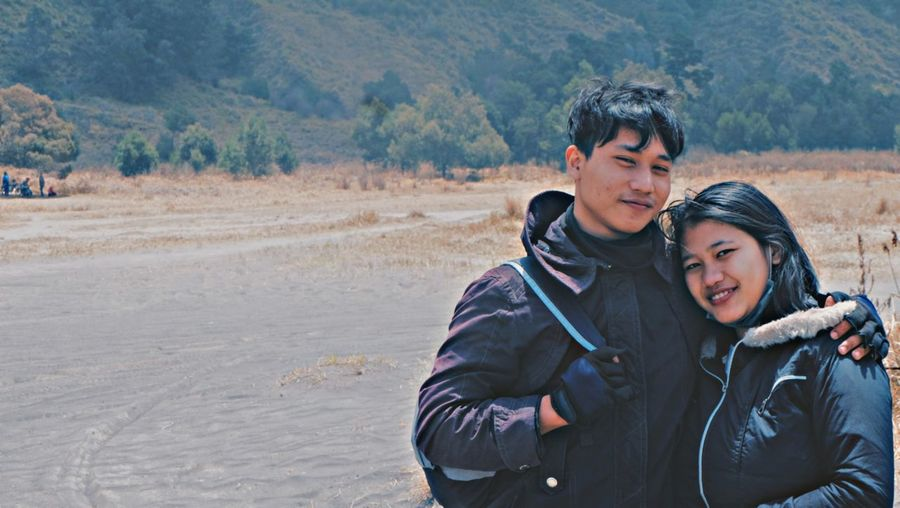 Portrait of happy young couple on land