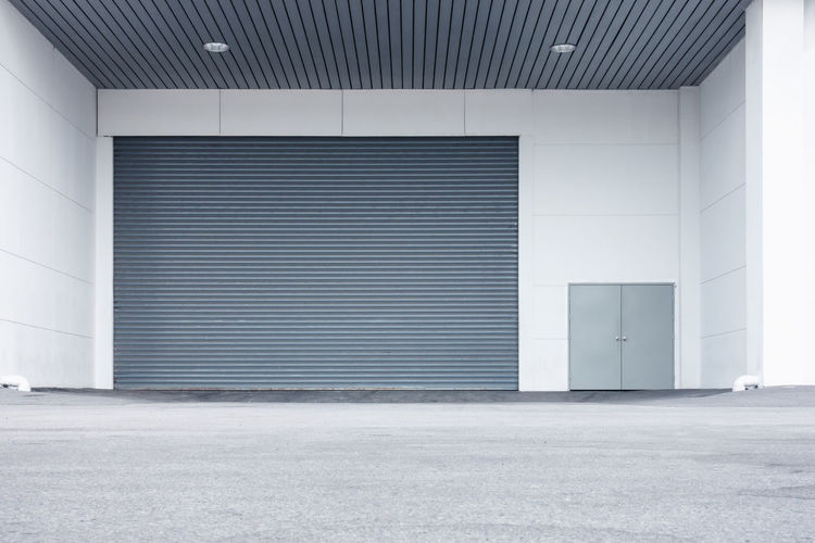 Shutter door Alloy Architecture Building Building Exterior Built Structure Business City Closed Day Domestic Room Door Empty Entrance Factory Garage Gray Iron Metal Modern No People Outdoors Shutter Steel Wall - Building Feature Warehouse