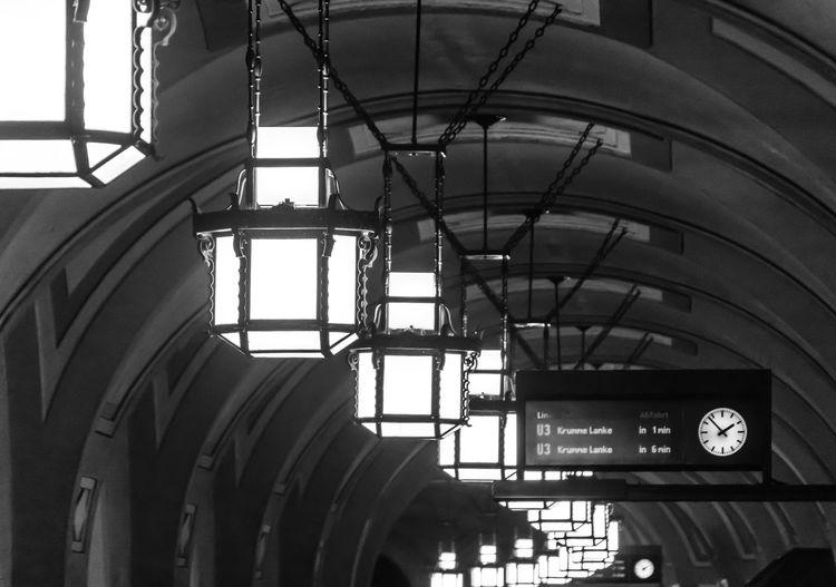 Illuminated Lighting Equipment Hanging At Railroad Station