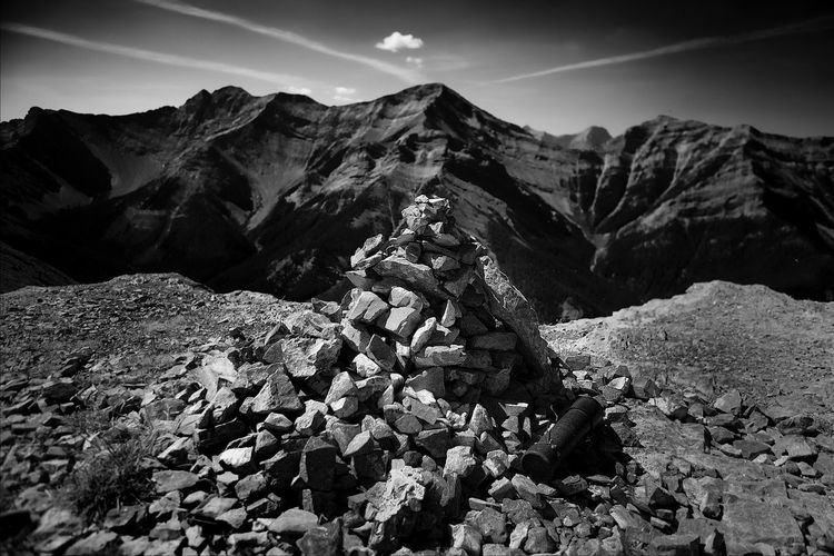Pile Of Stones Against Rocky Mountains