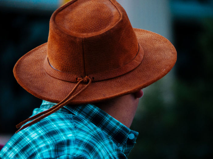 Rear view of person wearing hat standing outdoors