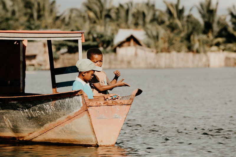 Children in water at shore