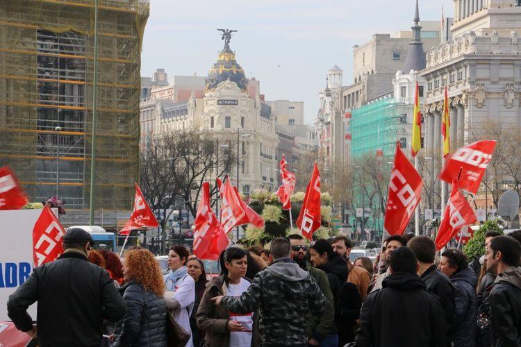 Group of people against buildings in city