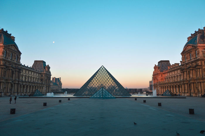 sunset at Louvre Architecture Architecture_collection City Cityscape France Louvre Paris Sunset_collection Travel Travel Photography Architecturelovers Museum Nopeople Noperson Sky Street Sunset Symmetrical Symmetry Symmetrykillers Symmetryporn Travel Destinations