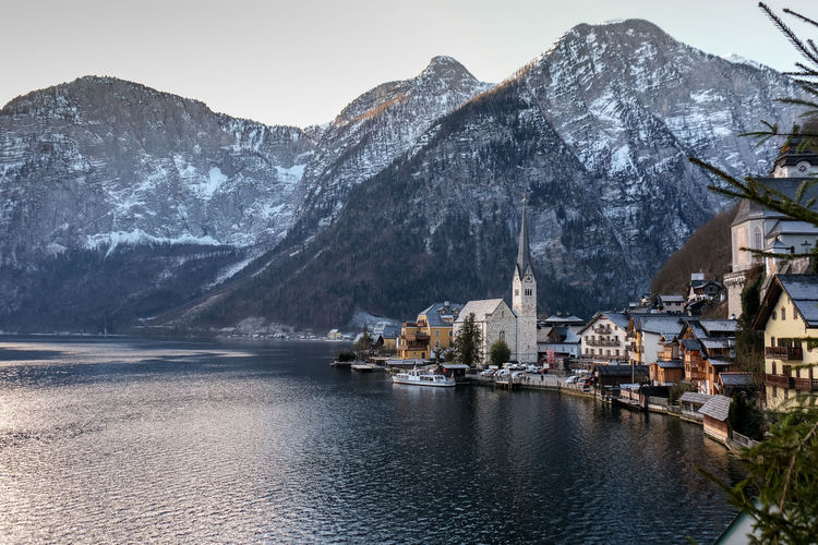 Scenic view of lake of hallstatt by mountain during winter