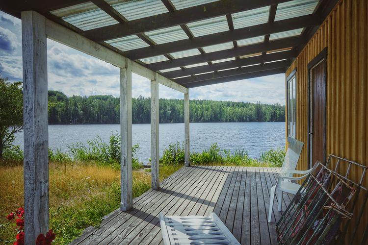 Scenic view of lake seen through window