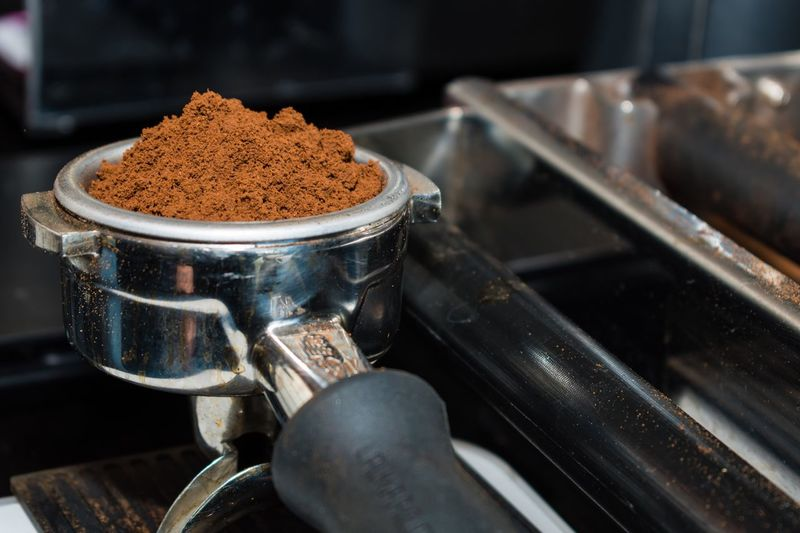 Close-up of ground coffee in container