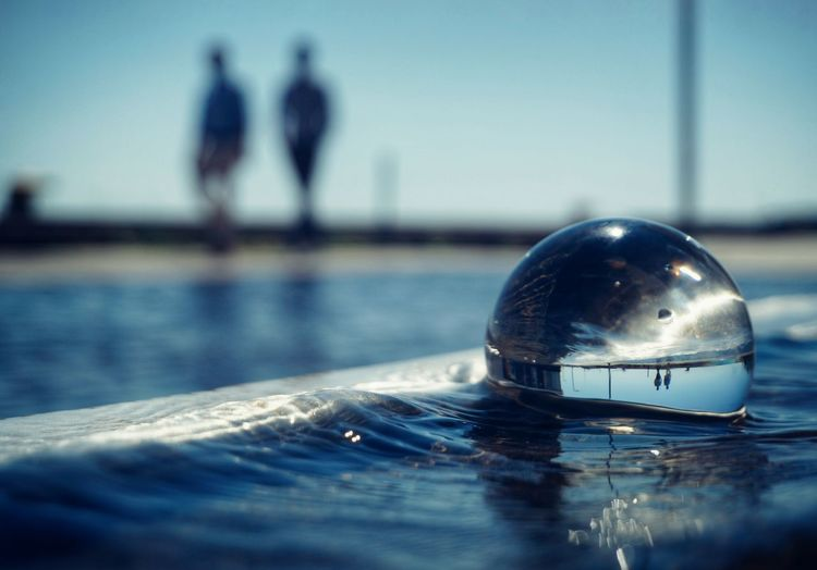 Close-up of crystal ball on water