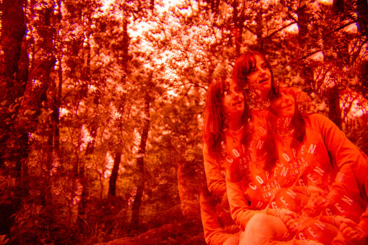 Future Eyes Lens Lomography Prism Prism Art Redscale Red Filter Tree Plant Autumn Forest Orange Color One Person Nature Red Land WoodLand Adult Young Adult Day Women Waist Up Front View Plant Part Emotion Spooky Change