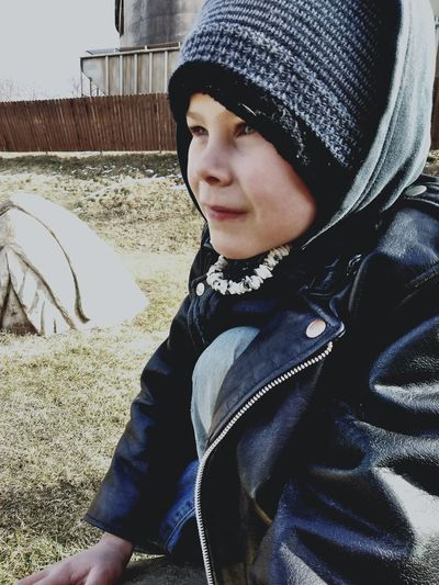 Close-up portrait of boy in park during winter