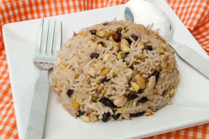 Mixed rice, beans, black bean red beans tenykhry pearl barley or adlay and grain on white dish. Adlay Bean Black Bean Brown Color Cereals Close-up Food Grains Healthy Eating Milled Rice Imperfectly Cleaned Millet No People Plate Ready-to-eat Soybean Sprouted Pea Tenykhry Unpolished Rice Vegetarian Food