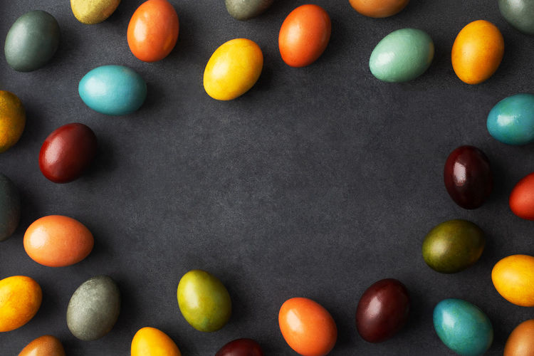 Directly above shot of multi colored candies against black background