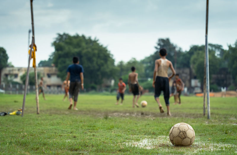 People playing soccer ball on field
