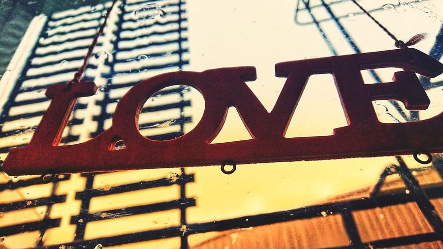 Close-up of rusty sign on wall