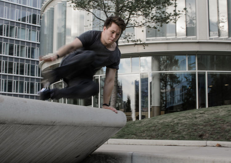 Low angle view of man free running
