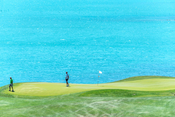 Adult Adults Only Black Sea Blue Day Golf Golf Club Golf Course Golfer Grass Green - Golf Course Green Color Leisure Activity Men Nature Only Men Outdoors Putting Green Putting Green Flag Sand Trap Sea Sport Sportsman Thracian Cliffs Golf Course