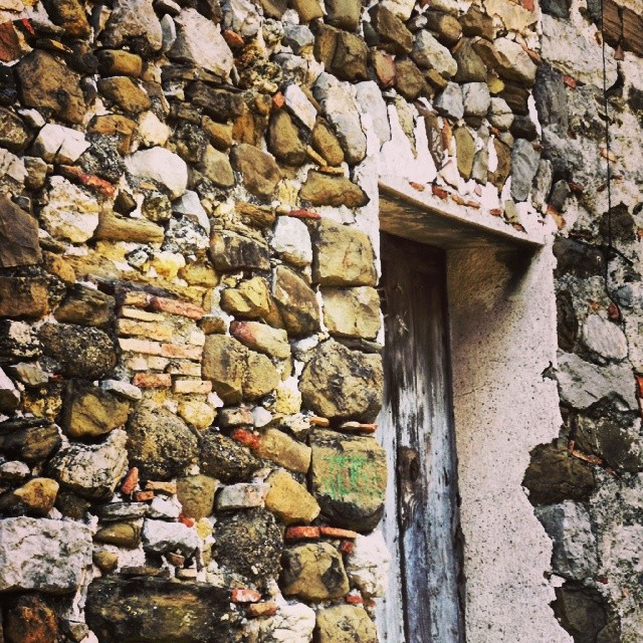 architecture, built structure, stone wall, building exterior, brick wall, wall - building feature, old, textured, weathered, house, wall, window, outdoors, brick, day, no people, stone, stone - object, low angle view, damaged
