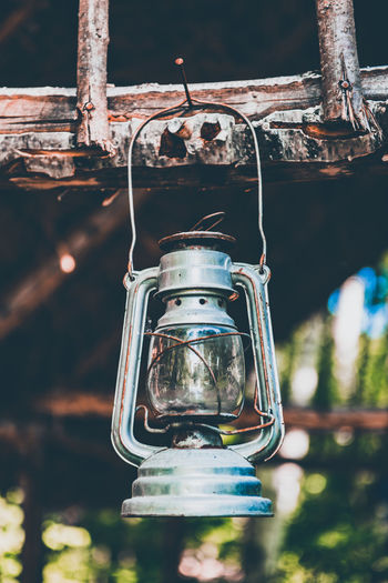 Low angle view of old lantern hanging at night