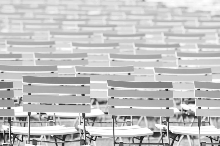 White chair rows in a spa park in black and white Seats In Row Theater Backrests Black And White Black And White Photography Chair Chairs Chairs Seats Education Empty In A Row Large Group Of Objects Open Air Park Seat Seating Seats Row Uncomfortable