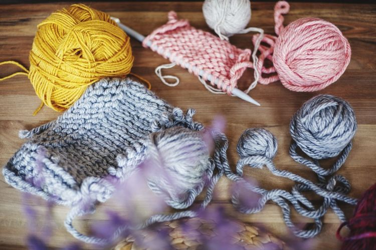 High angle view of wools on wooden table