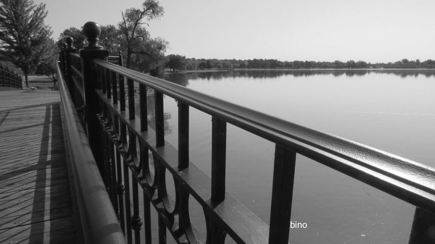 Early Morning At The Lake From The Footbridge Over The Railing No People Still Water Black And White Photography Lake Cadillac Pure Michigan
