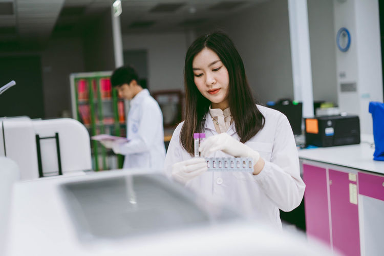 Scientist holding test tube at laboratory