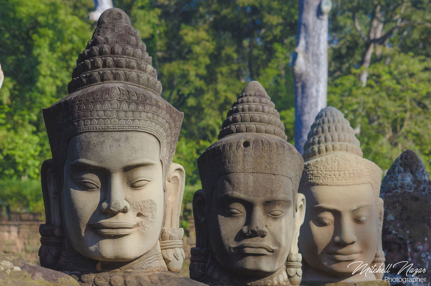 Angkor Thom Angkor Wat, Cambodia Angkor Wat, Temples, Kmer Culture Cambodia Sien Reap Angkor Angkor Wat Angkorwat Art And Craft Close-up Day Focus On Foreground Human Representation Male Likeness No People Outdoors Religion Sculpture Spirituality Statue Tree