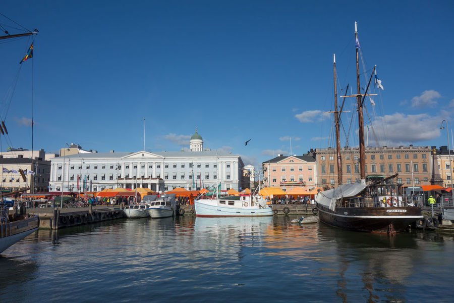 Architecture Boat Building Exterior Built Structure Capital Cities  City City Life Connection Development Famous Place Human Settlement Mode Of Transport Nautical Vessel Residential District Transportation Travel Water Waterfront Tourism Helsinki Finland Kauppatori City Center Landmark Seeing The Sights