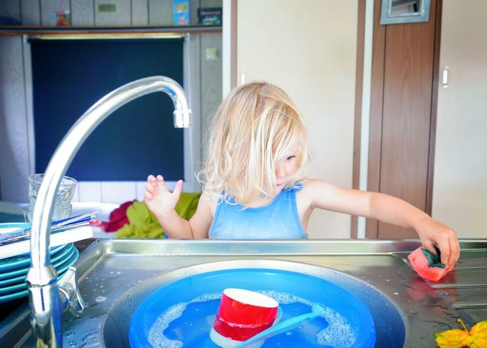 Cute Girl Washing Sink In Kitchen