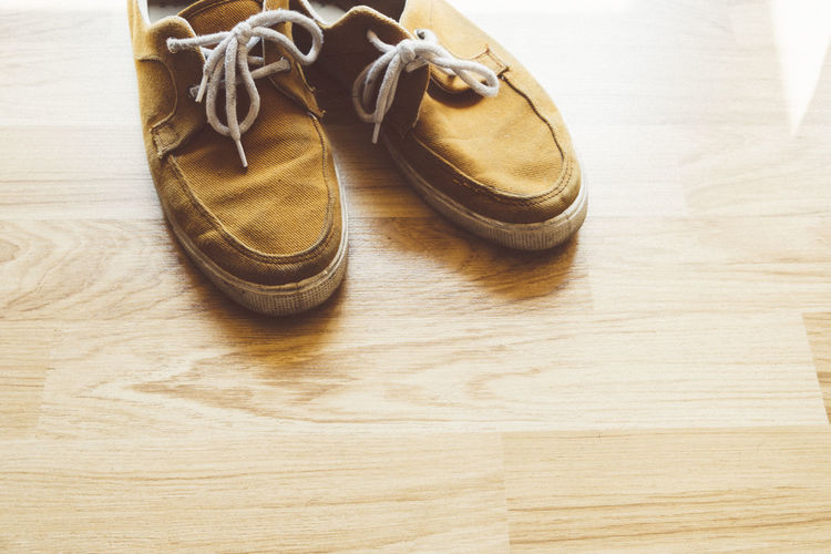 High angle view of shoes on wooden table