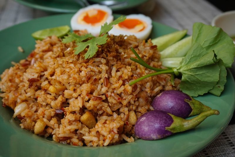 Fired rice with pork Easyfood Egg Fired Rice Food And Drink Food Freshness Ready-to-eat Close-up Serving Size Healthy Eating Focus On Foreground Vegetable Meat Table Meal Plate Leaf Still Life