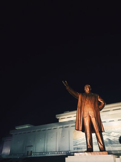 Low angle view of statue at night