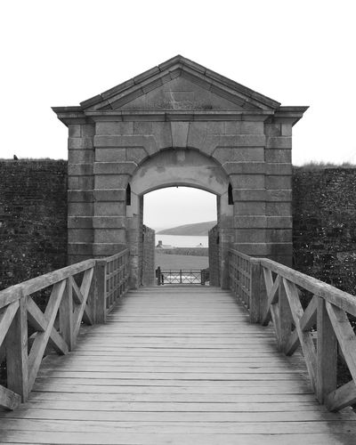 Fort Charles Kinsale Fort Architecture History Tourism Entrance Over The Bridge Looking Through Walkway Cloudy Day Black And White Wooden Bridge Exceptional Photographs Eye For Photography Monochrome Photography