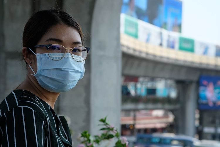 She wear mask protect air polution Portrait Headshot One Person Focus On Foreground Looking At Camera Young Adult Real People Healthcare And Medicine Glasses Adult Built Structure Architecture Young Women Building Exterior Close-up Eyeglasses  Doctor  Obscured Face Human Face Care