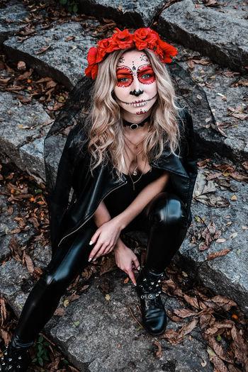 Closeup portrait of calavera catrina. young woman with sugar skull makeup. dia de los muertos. day