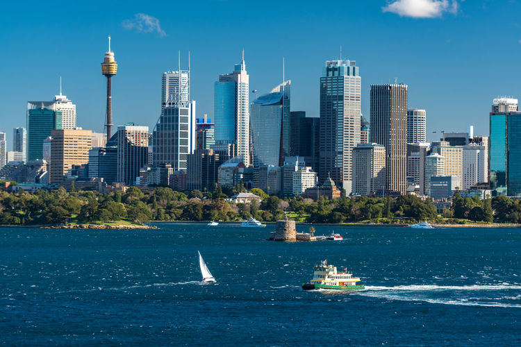 Sydney cityscape of Sydney CBD and Sydney Tower with ferries and yachts over Sydney Harbour Australia Cityscape Exotic Ferry Royal Botanic Gardens Transportation Blue Building Capital Cities  Central Business District Famous Place High Angle View Iconic Idyllic Office Buildings Sail Skyscraper Smart City Sport Summer Sydney Tall Transportation Building - Type Of Building Urban Urban Skyline