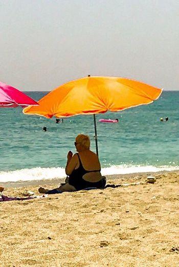 Beach, Umbrella, Sitting Water Women Leisure Activity Nature The Great Outdoors - 2017 EyeEm Awards Colour Your Horizn