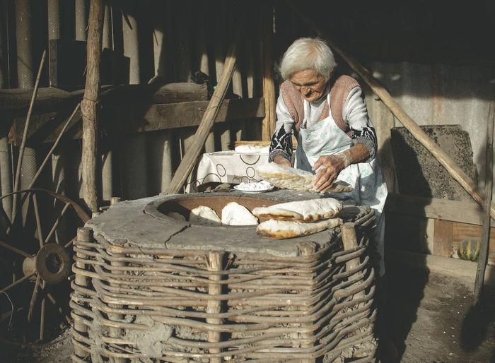 Senior woman working in workshop