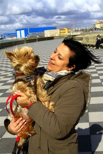 One Animal Adults Only Adult Women Domestic Animals Real People Vento Tra I Capelli Ventochespettina💗 Vento My Wife ❤ My Dog Capture The Moment Italy Io Sono Leggenda EyeEm Best Shots Italia One Person Winter Warm Clothing Personal Perspective Livorno Beach