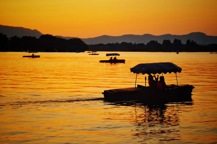 Sunset Silhouette Water Lake Reflection Outdoors Nature Nautical Vessel Landscape Scenics Sky Travel Destinations China View Yellow West Lake, Hangzhou Hangzhou,China Light And Shadow Vacations Lake View Warm Glow Travel Mountain Range Boat Summer Beauty In Nature