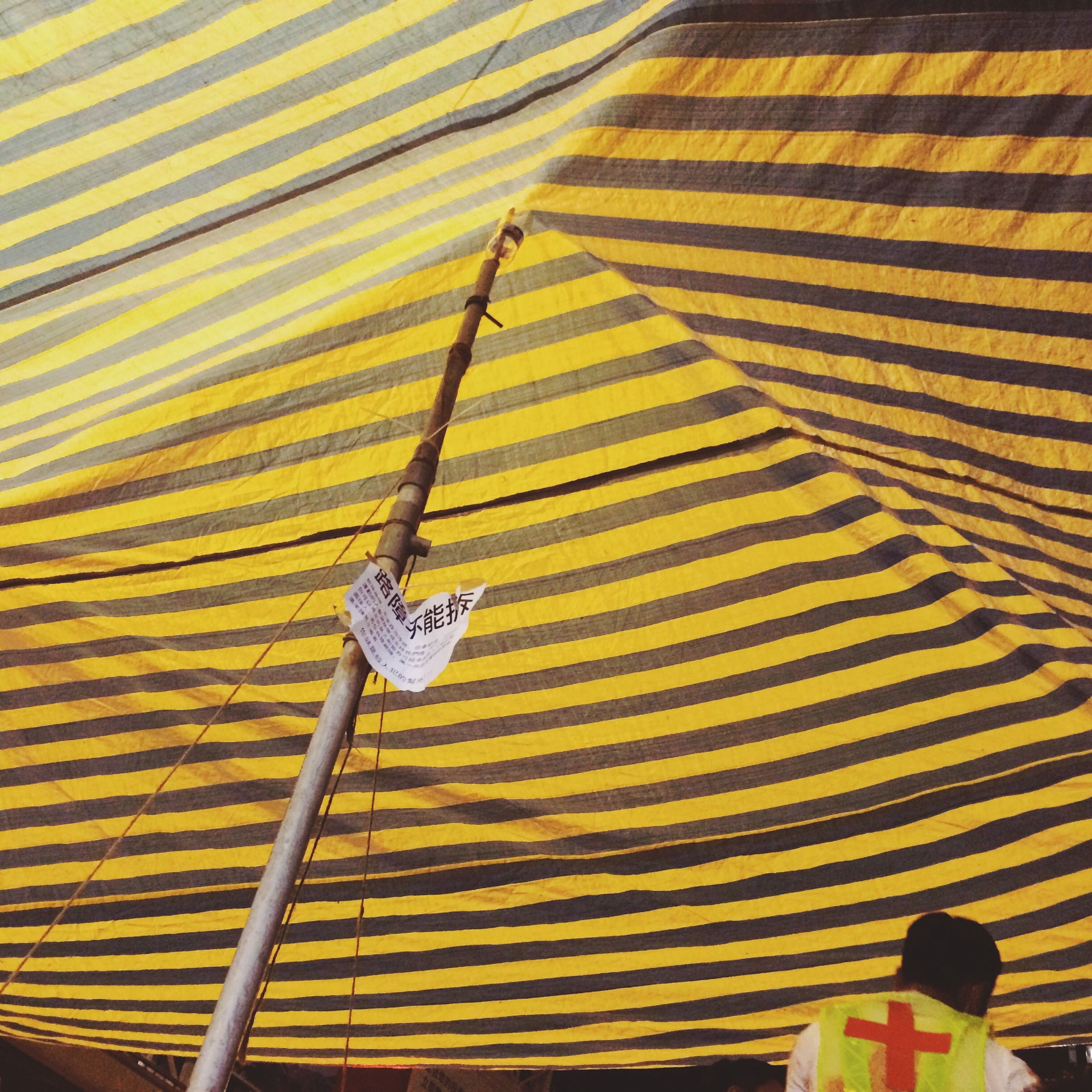 yellow, high angle view, flag, outdoors, patriotism, day, identity, pole, transportation, hanging, travel, low angle view, part of, rope, pattern, men, leisure activity, protection