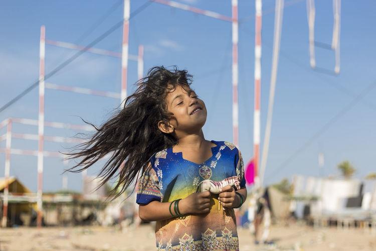Portrait of girl against sky