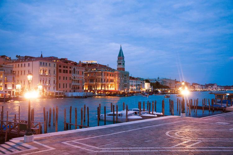Illuminated city buildings at waterfront