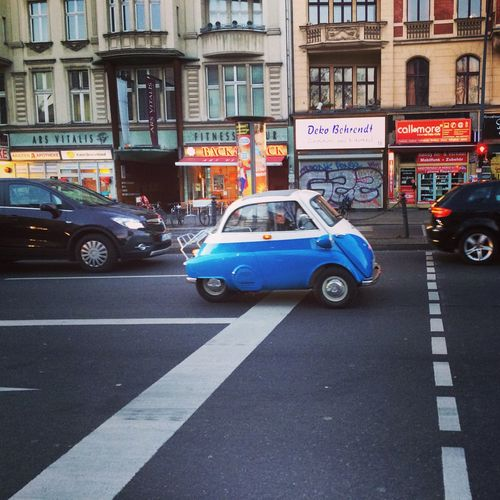Blue Car Bmw Building Exterior Car City Day Isetta Isetta BMW No People Outdoors Road Small Car Street Traffic Transportation Yellow Taxi
