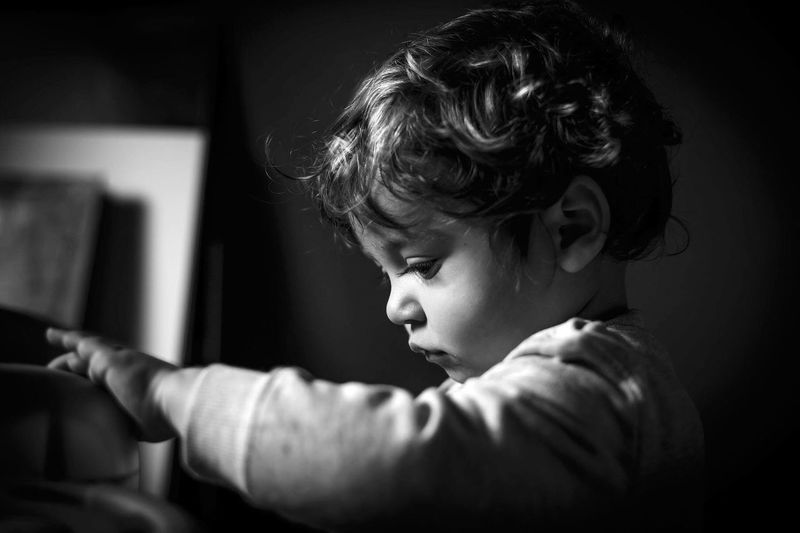 Close-up portrait of boy looking at home