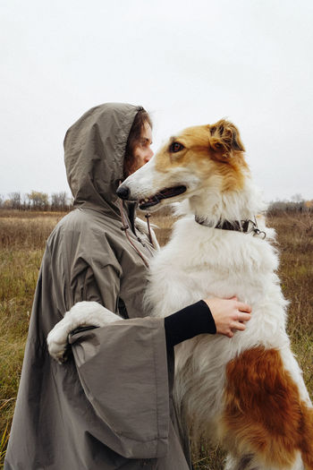 Domestic Dog Mammal One Person One Animal Pets Side View Nature Outdoors Domestic Animals Field Pet Owner Real People Portrait Woman Autumn Hunting Hunter Borzoi Attention Fall Dogs Hunting Dog Looking Away Animal Themes